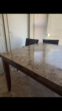 Large marble table w/ 6 leather chairs Laurel