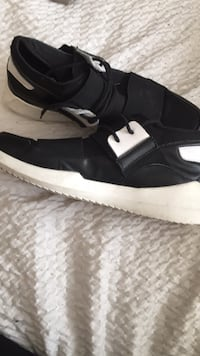 pair of black-and-white Nike sneakers 794 km