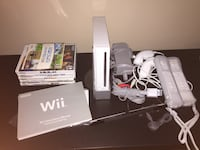 white and grey nintendo wii console, controller, remotes, fit board and game lot San Jose, 95128