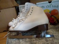 pair of white ice skates WASHINGTON