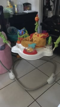 Yellow, white, and green Lion jumperoo