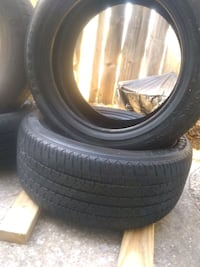 four black vehicle tires with wheels Oklahoma City, 73112