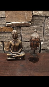 two brown wooden candle holders Laval, H7R 4V2