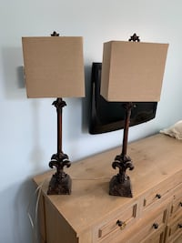 two black base white shade table lamps