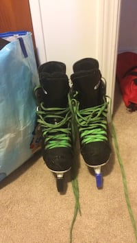 Pair of black-and-green inline skates