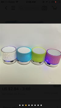 Four assorted color plastic containers