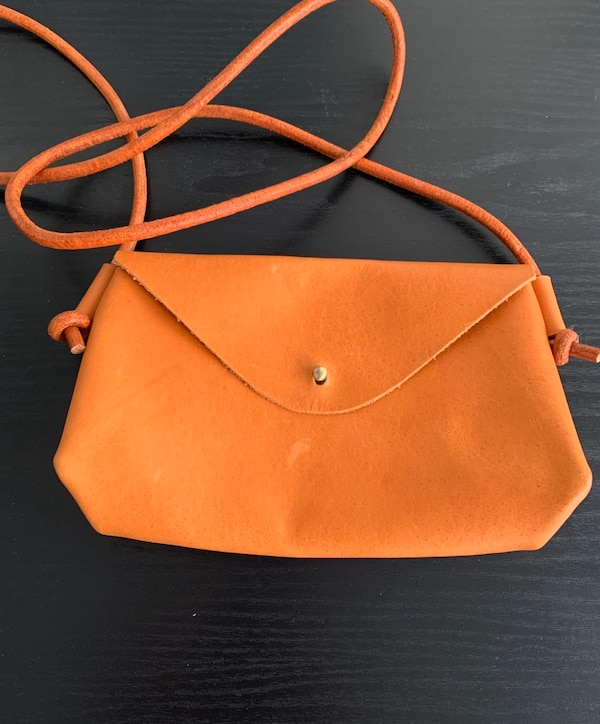 Handcrafted natural tan leather crossbody purse. 82710fc6-6cd1-4cf3-8e07-18163c8aea04