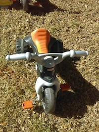toddler's orange and gray pedal trike