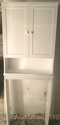 Toilet top cabinet. Size 24.5 x 8.25 x 66.5 tall