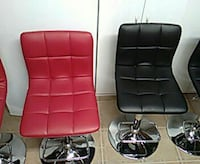 two red & two black leather padded chairs