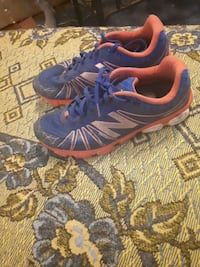 pair of blue-and-orange Nike running shoes Hamilton