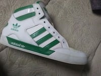 unpaired green and white Adidas high-top sneaker Georgia 124