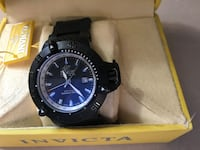 Round black analog watch with black strap in box