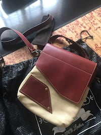 """Deoni leather and canvas side bag. Approx 9x11""""   Retailed for $125, new. Never used   Monrovia, 91016"""