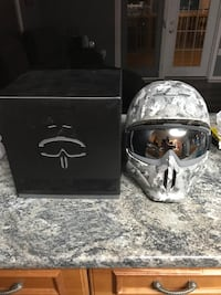 Grey and white camouflage helmet with goggles Cold Lake, T9M 1H9