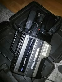 black and gray Philips video camera with case