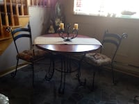 Round glass top table with four chairs dining set Mascouche, J7K 2H4