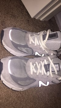 pair of gray-and-white Nike running shoes 27 mi