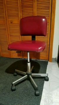 Red leather rolling chair. Queens, 11375
