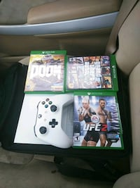 white Xbox One console with controller and game cases Greensboro, 27407