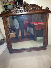 square mirror with brown wood frame