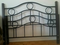 two black metal Size Queen headboard and footboard