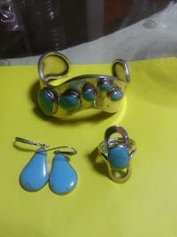 silver-colored blue cabochon bangle, ring, and earrings set