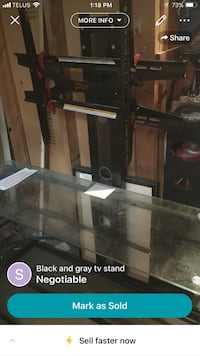 Tv stand. 3 glass shelves  St Catharines, L2R 1E9