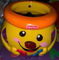 yellow and red Fisher-Price learning toy 47 km