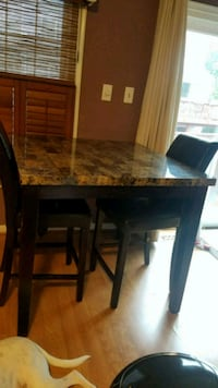 Kitchen table. Throwing in 2 used chairs. Springfield, 22150