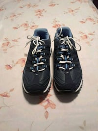 pair of black Nike running shoes Jacksonville, 32218