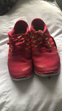 pair of red Nike running shoes Tallahassee, 32304
