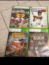 four Xbox 360 game cases Stratford, N5A