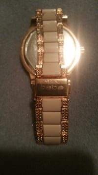square gold-colored analog watch with link bracelet Calgary