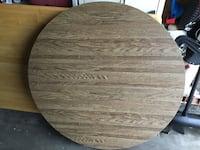 Round brown wooden table with 2 leafs-moving.  Must sell. Ames, 50014