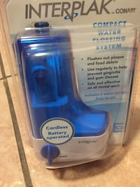 Anti-plaque contact water flossing system