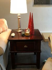 Brown wood tv unit and side table