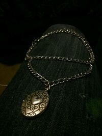 Silver locket with matching necklace. Medicine Hat, T1A 5E8