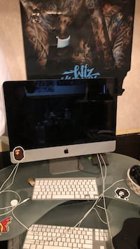 silver iMac with Apple Magic Keyboard and Magic Mouse 1951 km