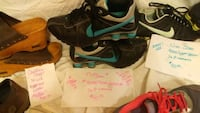 pair of black-and-green Nike running shoes Benton, 72015
