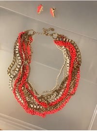 Hot pink, cream and gold chain necklace.
