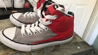 Pair of red-and-white high top sneakers