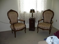 two brown wooden framed padded armchairs Toronto