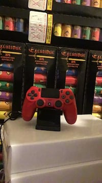 Black and red ps4 controller  Los Angeles, 90011