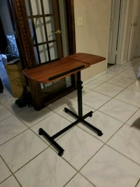 brown wooden folding table with black metal base Fort Lauderdale, 33312