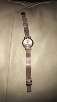 round silver analog watch with black leather strap Rochester, 14609