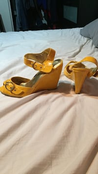 pair of yellow open-toe wedge sandals