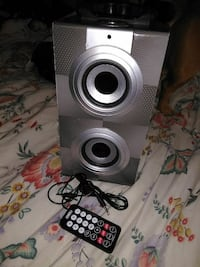 grey multimedia speaker with remote