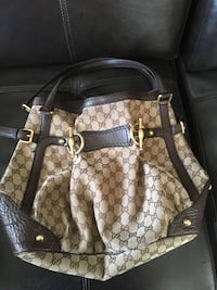 Brown and beige Gucci two-way handbag.