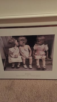 three children painting with white wooden frame